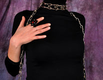 Girl in black. Closeup look at girl in black blouse,hand with leather ring Stock Images