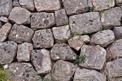 Stone wall. Closeup look of stone wall,seaside Royalty Free Stock Photography