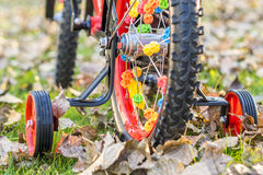 Closeup look of wheels full of ornaments. Of young child's bike with accessory wheels, first time on bike Stock Image