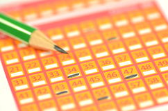 Closeup of lottery ticket and pencil Stock Photos
