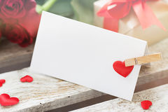 Closeup of love message on a wooden background with roses, gift Stock Photography