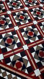 Traditional patterned pavement tiles. royalty free stock photos