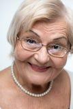 Closeup of lovely elderly woman Stock Photos