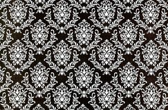 Printed damask repeat pattern background. A closeup of a lovely old fashioned shabby  chic damask pattern printed on a paper background Royalty Free Stock Images