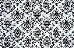 Printed damask repeat pattern background. A closeup of a lovely old fashioned shabby  chic damask pattern printed on a paper background Stock Photo