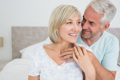 Closeup of a loving mature couple in bed Stock Photography