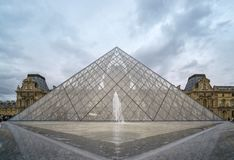 Closeup and low angle view of the Louvre glass Pyramid. stock image