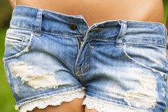 Closeup of low cut denim shorts Royalty Free Stock Images