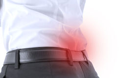 Closeup of lower back pain. Closeup of male with lower back pain. Red spot emphasizing sore area Royalty Free Stock Photo