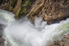 Closeup of Lower falls Yellowstone river. Raging waters. Spray from waterfall. Closeup of Lower falls Yellowstone river. Raging waters. Spray from waterfall Stock Photo