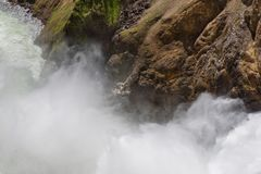 Closeup of Lower falls Yellowstone river. Raging waters. Spray from waterfall. Royalty Free Stock Photos