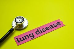 Closeup lung disease with stethoscope concept inspiration on yellow background stock image