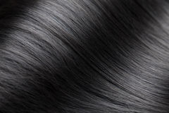 Closeup on luxurious glossy black hair Stock Images
