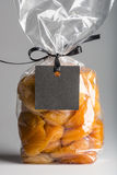 Closeup on luxury bag of candied apricots with blank label Royalty Free Stock Images