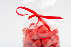 Closeup of luxury bag of candy strawberries with red ribbon Stock Images