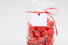 Closeup of luxury bag of  sugar strawberries with red ribbon Stock Photo