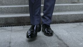 Closeup of luxury shoes, businessman walking downstairs, elegant rich person