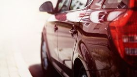Closeup luxury sport car on road. Closeup luxury sport car on the road Royalty Free Stock Image