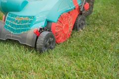 Closeup machine for cutting the grass on a lawn. Machine for cutting the grass on green lawn Royalty Free Stock Photos