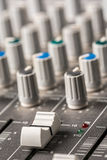 Closeup macro audio mixing console knobs and sliders. Stock Photo