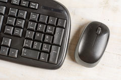 Closeup macro black pc keyboard with black wireless mouse Stock Photos