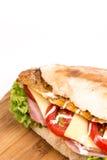 Closeup macro bread sandwich meat tomato cheese Stock Photography