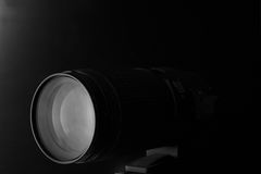 Closeup macro of camera lens with reflections low key image. Closeup macro of camera lens with reflections low key black and white image Royalty Free Stock Photos