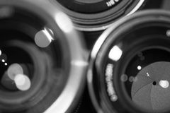 Closeup macro of camera lenses with reflections low key image Stock Images