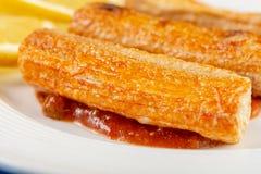 Closeup Macro Of Fried Surimi Sticks With Lemons On The Plate stock image