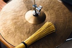 Closeup macro hi hat cymbal and brush. Concept concert, live music, performance, musical evening in a restaurant royalty free stock images