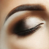 Closeup macro photo of woman closed eye with makeup Stock Images