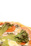 Closeup macro pizza slice with green lettuce and tomato Stock Photography
