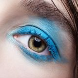 Closeup macro portrait of human female eye with blue smoky eyes make-up. Closeup macro portrait of human female eye. Woman with unusual evening beauty face royalty free stock photos