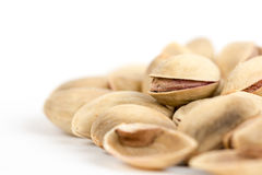 Closeup macro roasted pistachio over white background Royalty Free Stock Photo