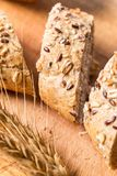 Closeup macro shot of bread with seeds sliced. Stock Photography