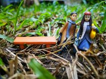 Closeup and macro shot of miniature people traveling with their suitcase. stock photo