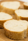 Closeup macro sliced french bread on the wooden board Royalty Free Stock Photography