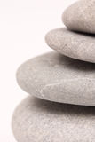Closeup macro view balanced grey stones abstract background Royalty Free Stock Images