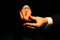 Closeup magician holding ring Royalty Free Stock Photography