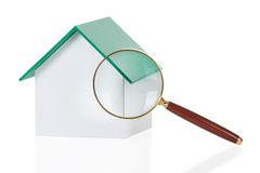 Closeup Of Magnifying Glass And House Model Royalty Free Stock Image