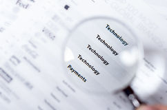 Closeup magnifying glass over paper with the words Stock Photos