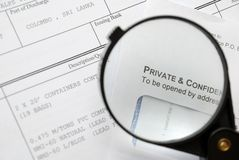 Closeup of magnifying glass on security Stock Images