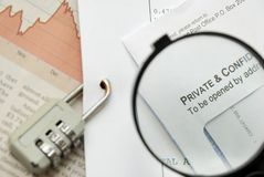 Closeup of magnifying glass on security Royalty Free Stock Photos