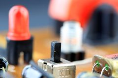 Closeup of main control switch on a circuit board. Stock Photo