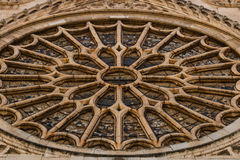 Closeup of the main rose window of Leon gothic cathedral in Spai. Closeup view of the entrance rose window with its stained glasses in the gothic cathedral of Royalty Free Stock Photo