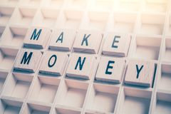 Closeup Of A Make Money Reminder Formed By Wooden Blocks On A Wooden Floor royalty free stock photo