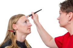Closeup of a makeup artist applying makeup Royalty Free Stock Photo