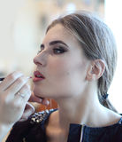 Closeup of a makeup artist applying makeup Royalty Free Stock Photos