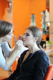 Closeup of a makeup artist applying makeup Royalty Free Stock Image