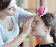 Closeup of a makeup artist applying makeup Royalty Free Stock Photography